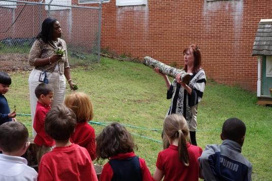 Ms. Hobgood and Ms. Huitt explain how mushroom logs will produce